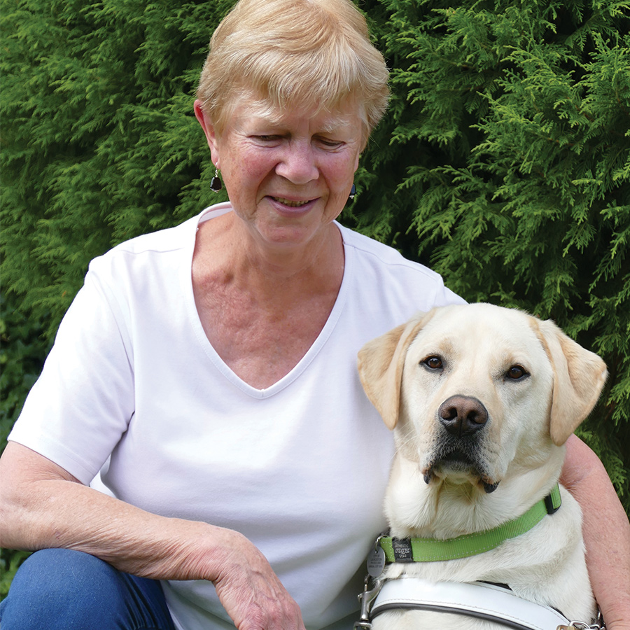 a lady with her guide dog