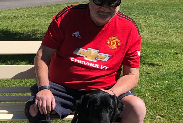 a client with a black dog