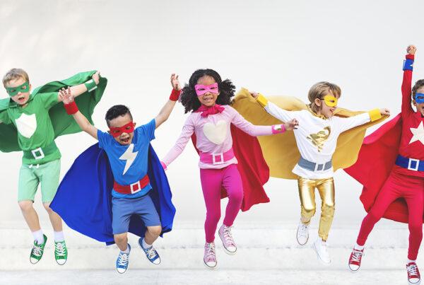 children dressed up in superhero costumes